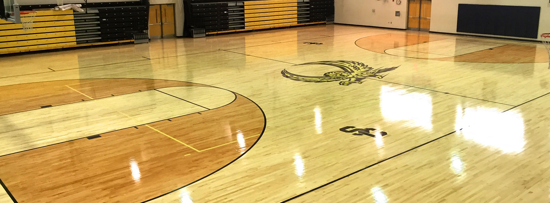 Basketball court flooring installation play on courts for Home basketball court cost